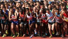 McCarthy and Simkiss start the 2014 London Marathon just off the shoulder of Mo Farah